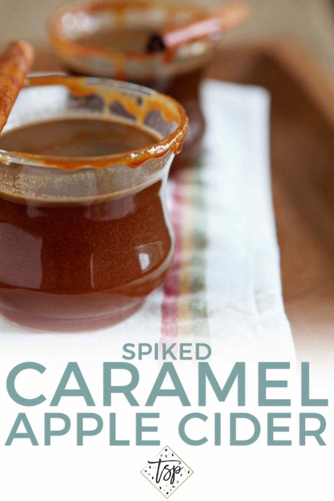 Pinterest graphic of Spiked Caramel Apple Cider, showing two glasses of the hot drink and Pinterest text