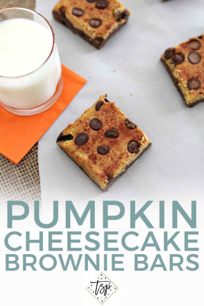 Pinterest image for Pumpkin Cheesecake Brownie Bars, featuring the cut bars on parchment paper with a glass of milk