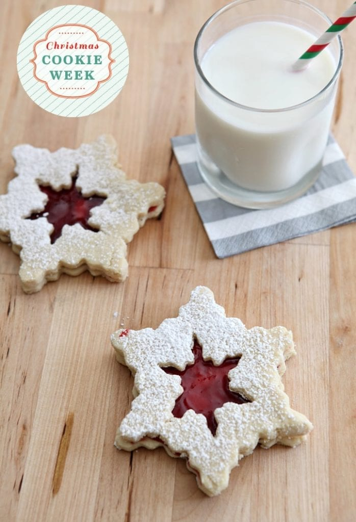 Slightly sweet shortbread-style cookies filled with a deliciously tart raspberry filling. These Raspberry Linzer Snowflake Cookies are the perfect balance for those who love the not-so-sweet desserts!