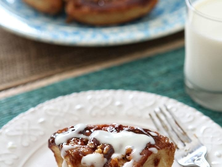 Decadent Walnut Sticky Buns, chock full of brown sugar, maple syrup and walnut goodness, are topped with a delightful Cream Cheese Icing to make the perfect plan-ahead Christmas morning treat.
