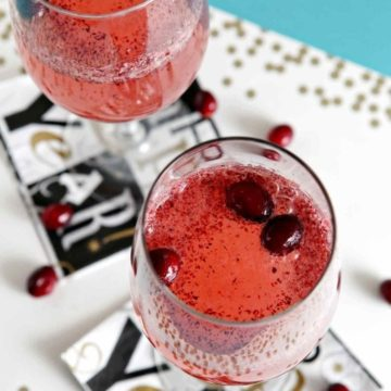Fresh cranberries, maple syrup, white grape juice and club soda make this delightful Cranberry Sparkler Mocktail into a New Year's Eve (or any other kind of celebration) drink! This alcohol-free drink is perfect for kids, expectant mamas and anyone else who don't drink alcohol.