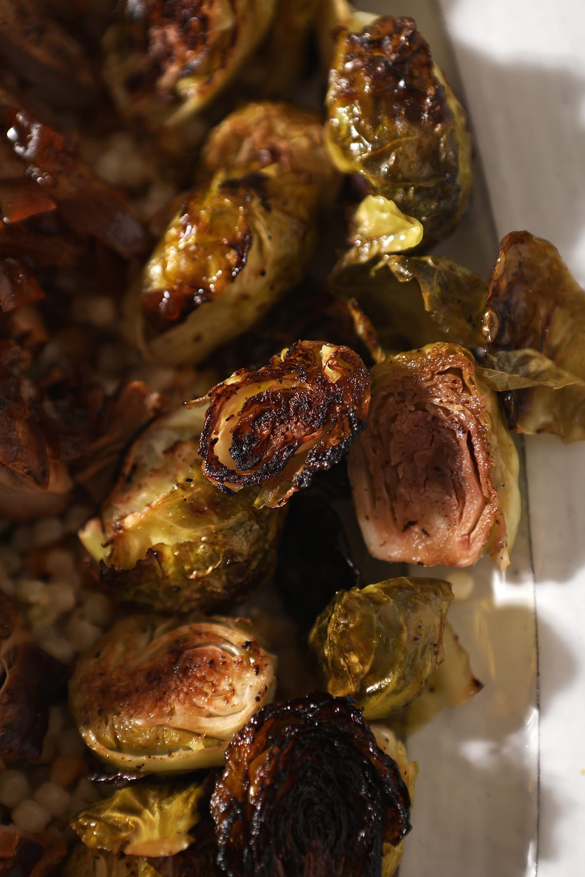 Roasted brussels sprouts on a white serving tray