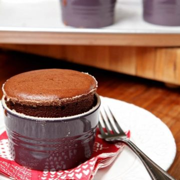 Dark Chocolate Soufflés are served on white plates for Valentine's Day