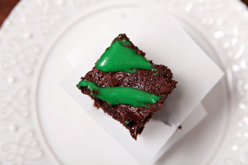 These decadently rich Guinness Brownies with Cream Cheese Frosting Drizzle are the perfect dessert to bake for your St. Patrick's Day celebration. Dense, dark chocolate brownies topped with a festive green cream cheese frosting drizzle... what's not to love?