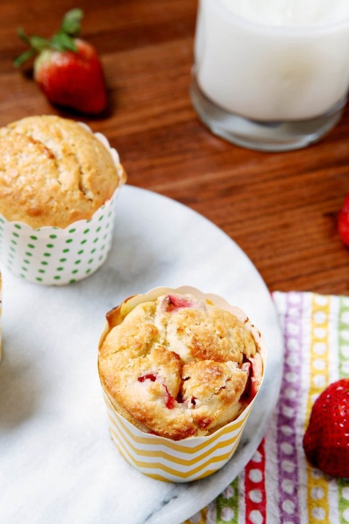 Start off your day right with tart and sweet Strawberry Lemonade Muffins. These breakfast muffins taste like the springtime and are a delicious breakfast.