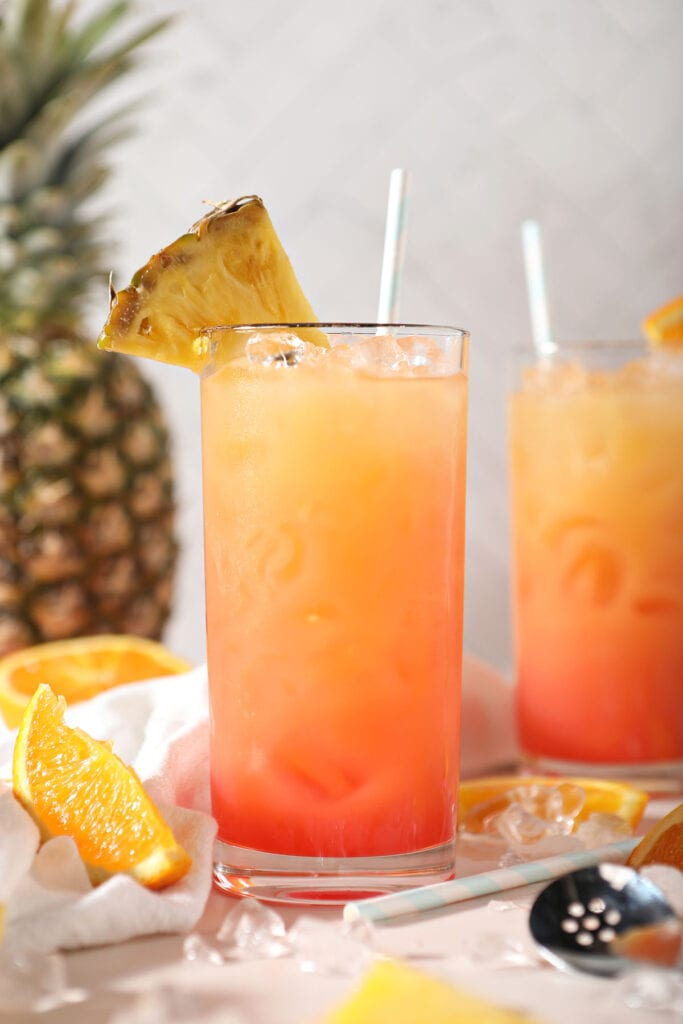 Two Sweet Sunrise easy cocktails garnished with pineapples