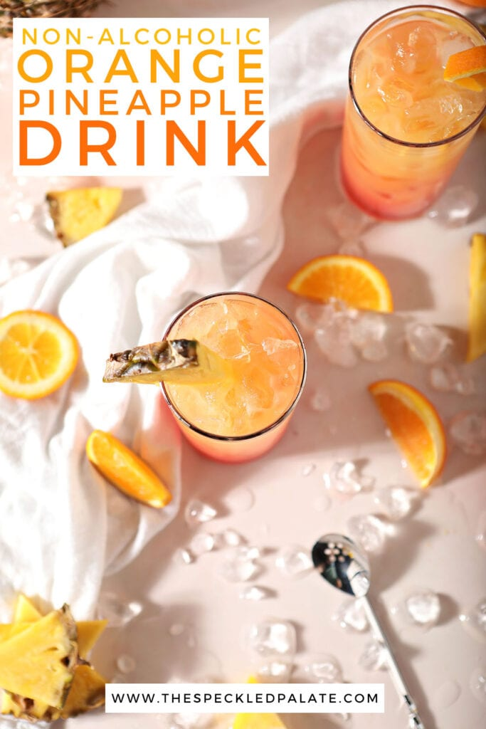 Two glasses of an orange drink surrounded by oranges and pineapples with the text non-alcoholic orange pineapple drink