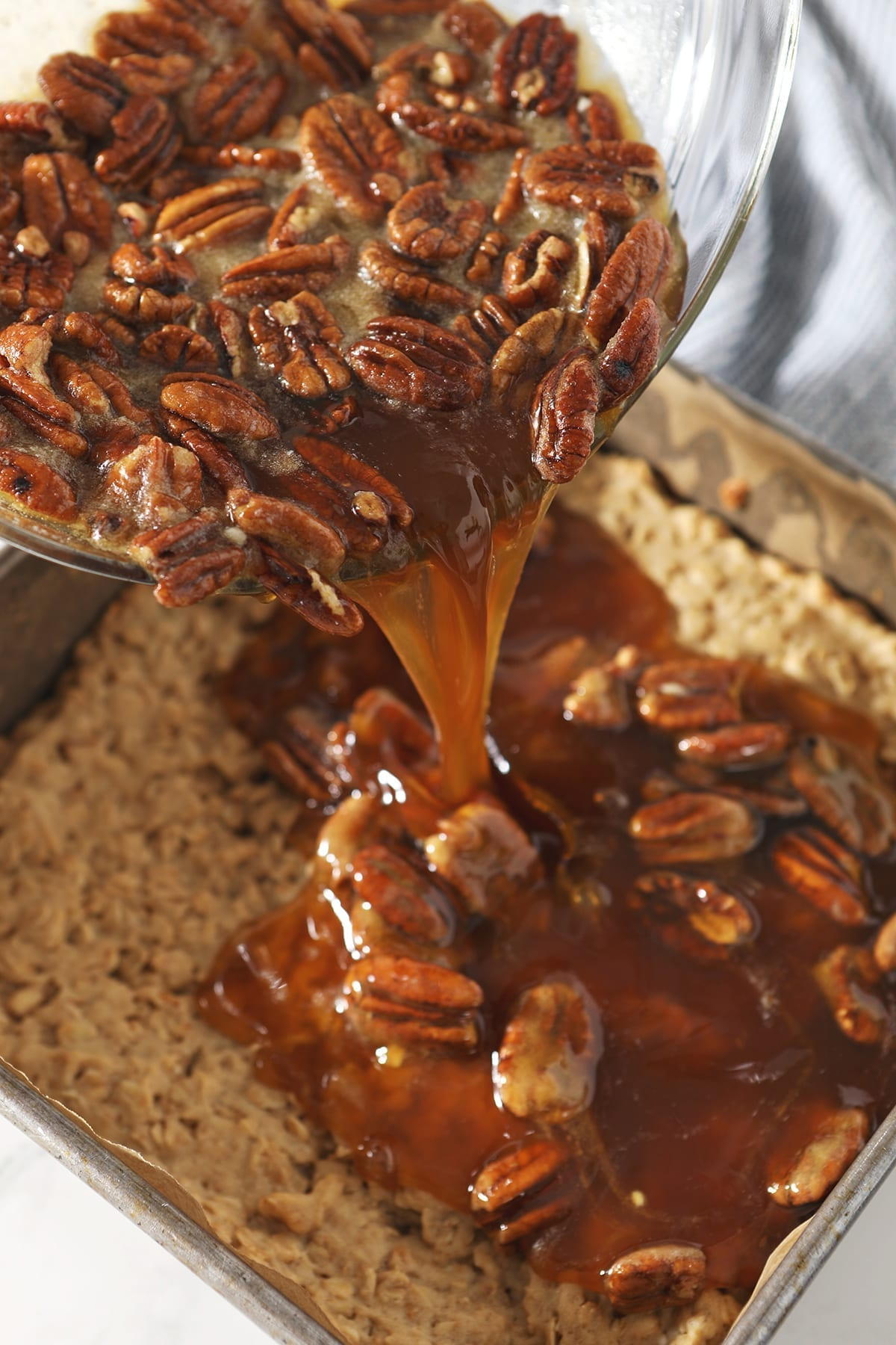Pecan halves and the filling pours on top of the pre-baked pie bar crust