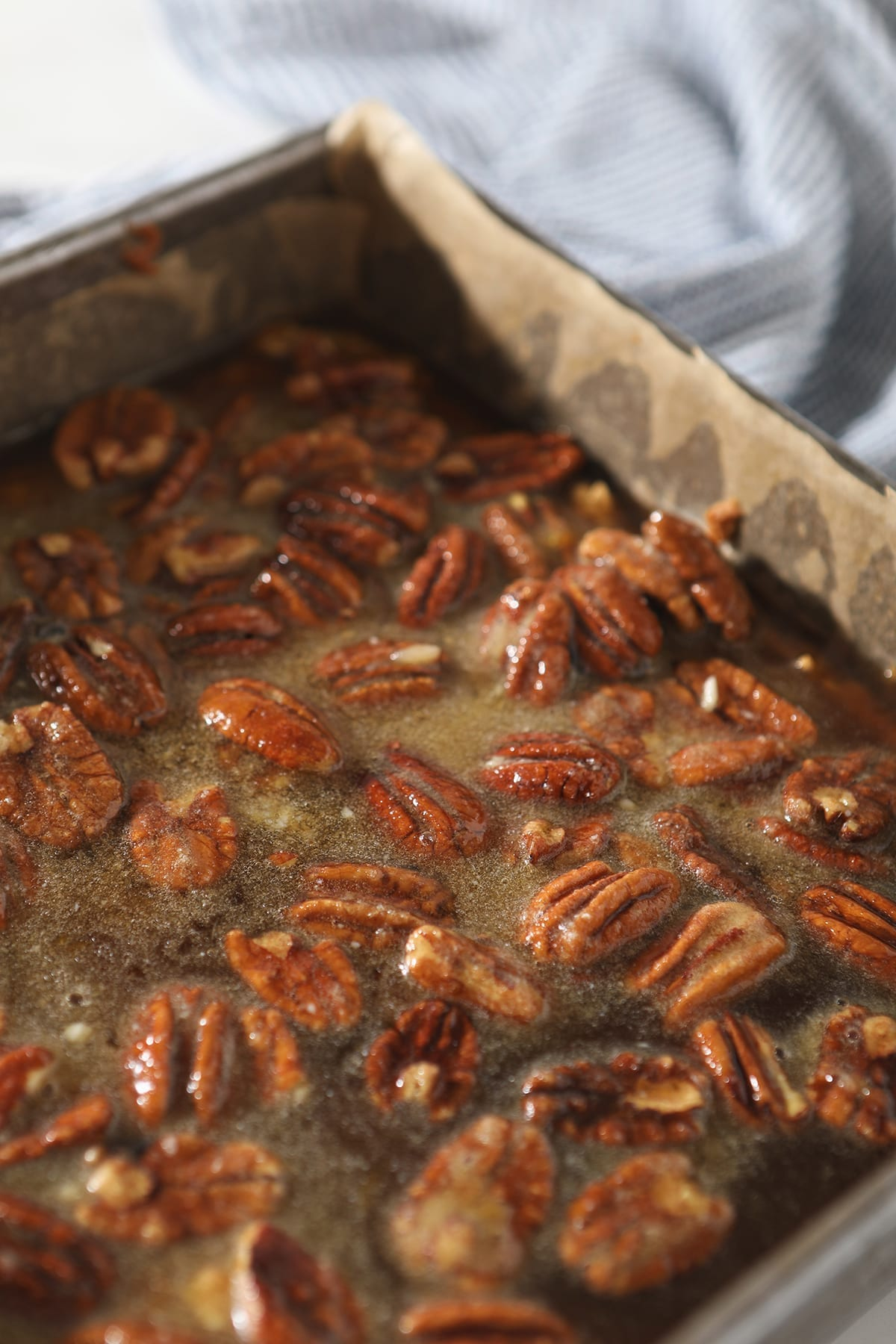 The Bourbon Pecan Pie Bars in a square baking dish before baking