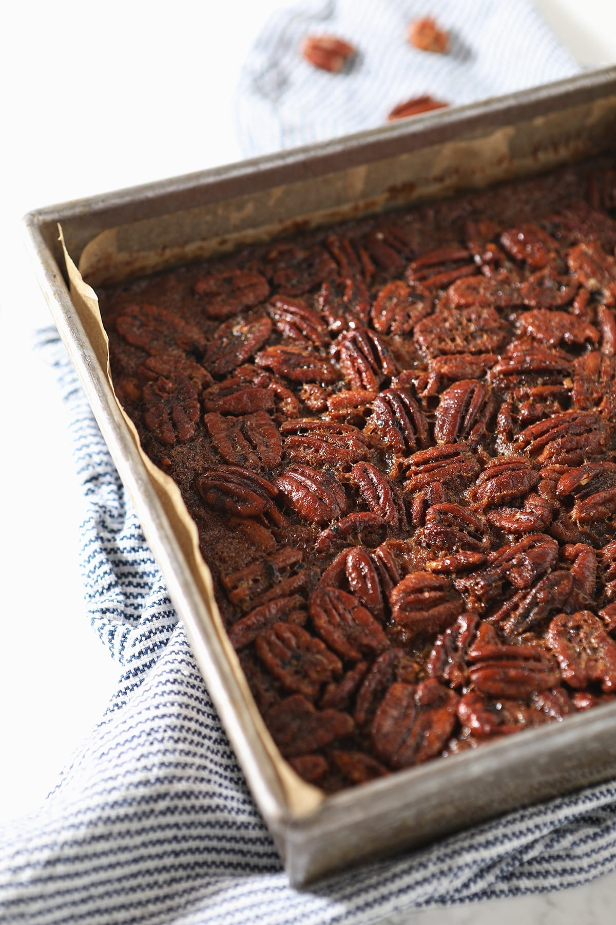 The Bourbon Pecan Pie Bars in a square baking dish after baking