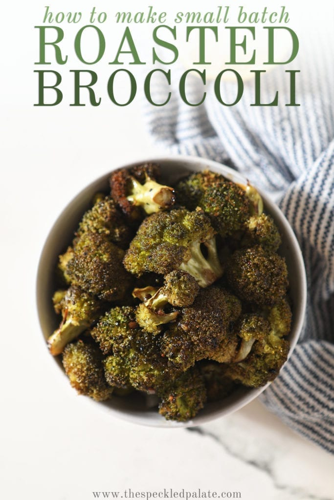 Roasted Broccoli in a bowl sitting on top of a blue and white striped towel next to a lemon wedge with the text 'how to make small batch roasted broccoli'
