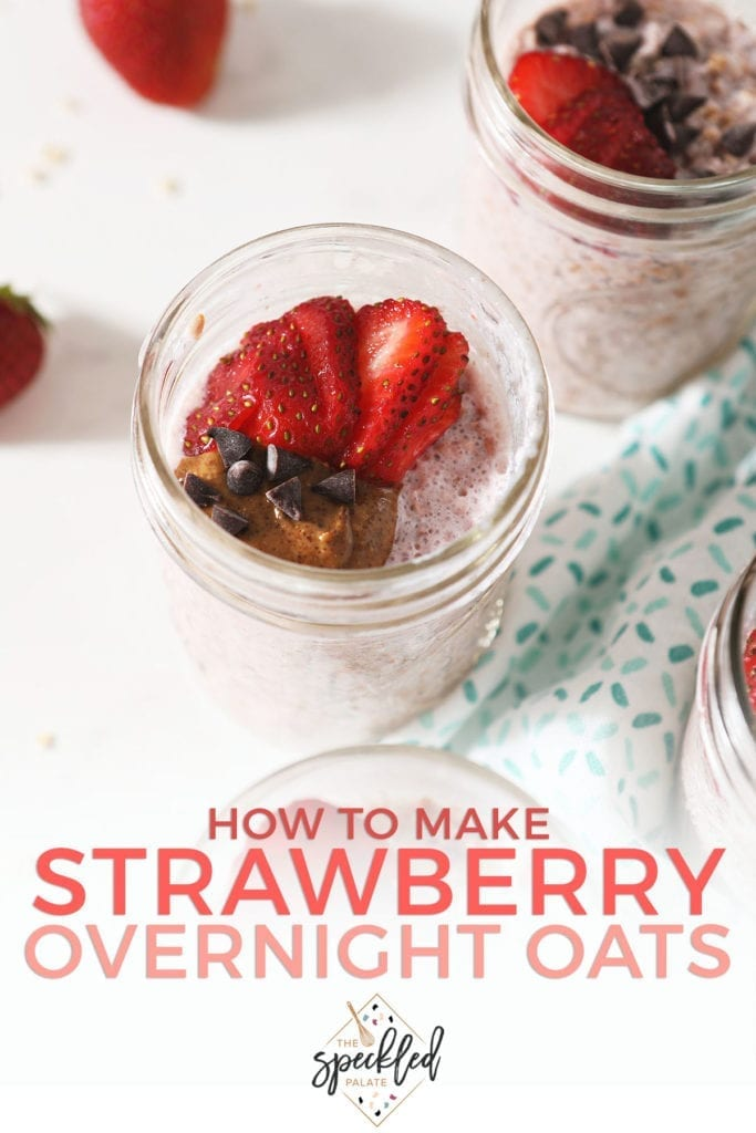 Close up of strawberry overnight oats in a mason jar garnished with almond butter, chocolate chips and sliced strawberries with the text 'how to make strawberry overnight oats'