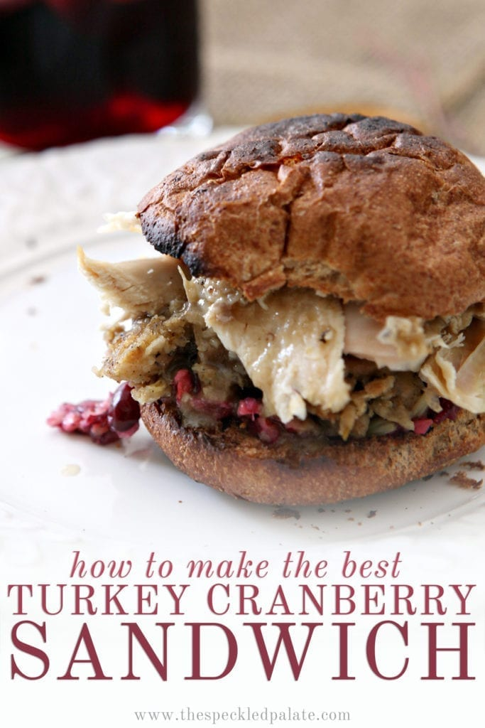 Close up of a sandwich with cranberry, turkey, stuffing and more with the text 'how to make the best turkey cranberry sandwich'