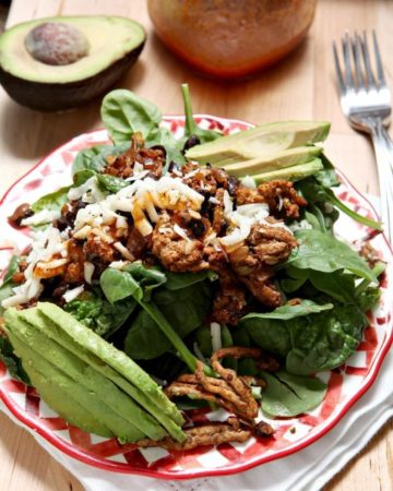 Turkey Taco Salad | Celebrate Cinco de Mayo at home with this delicious Turkey Taco Salad. Ground turkey, onions and black beans are sautéed together, then placed on a bed of spinach with various other toppings to make a tasty TexMex meal. Drizzle with a homemade Catalina dressing to finish. Easy to personalize, this Turkey Taco Salad is well-loved and perfect for a weeknight meal.