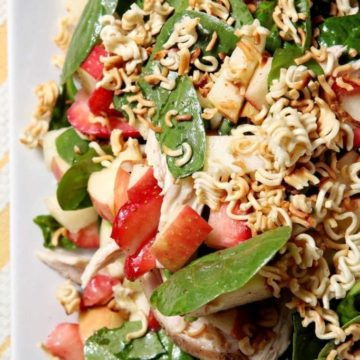 Chicken, Strawberry and Apple Summer Salad | Spinach salad, studded with roasted chicken breast, fresh strawberries and apples, tastes like the summertime! Topped with a sweet and simple Honey Vinaigrette and toasted Ramen Noodles, this salad is perfect for a crowd or a quick lunch.