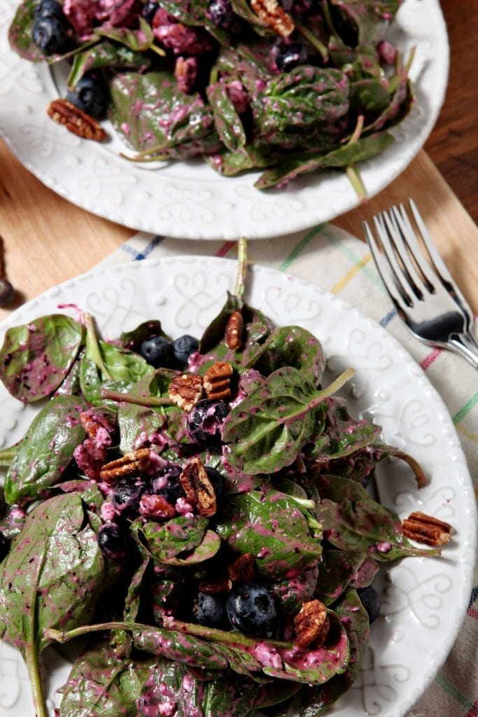Two plates of Blueberry Pecan Feta Salad, tossed and ready for eating