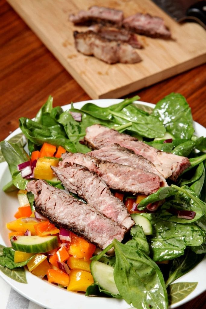 Summertime salads are delicious, especially when they call for all kinds of fresh vegetables. This salad utilizes fresh spinach, sweet peppers, cucumber and red onion, is tossed with a simple mustard vinaigrette and then is topped with leftover (or freshly cooked) steak! What's not to love?