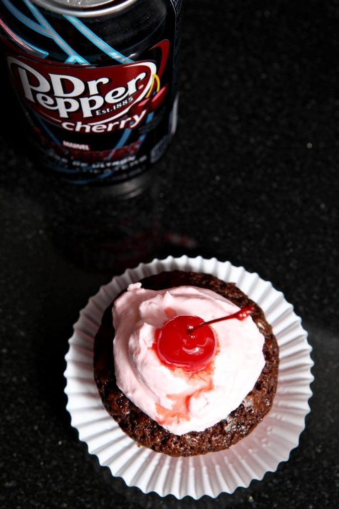 Celebrate summer by baking Dr. Pepper® Cherry Cupcakes, topped with an utterly decadent Grenadine Whipped Cream. These cherry chocolate cupcakes taste like a hot summer's day and are the perfect treat to enjoy after a day in the sunshine. #ShareFunshine #CollectiveBias
