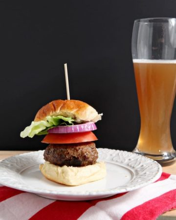 Juicy Lucy Burgers | Ground beef burgers, stuffed with sharp cheddar cheese, are the perfect compliment to a summertime celebration. These Juicy Lucy Burgers are a showstopper, whether you're hosting folks for a barbecue or rained out indoors.