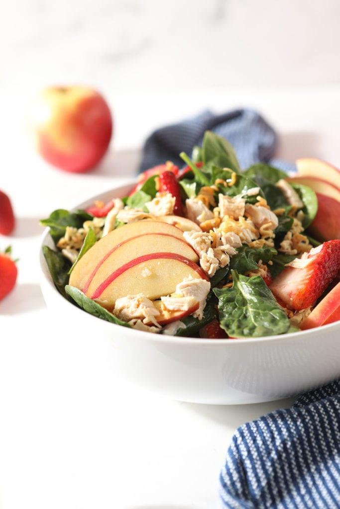 A bowl of chicken apple salad