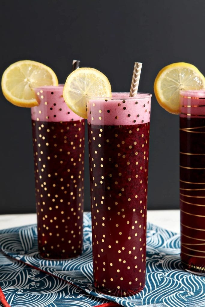 Celebrate the weekend by making this naturally sweetened Spiked Blueberry Lemonade! Fresh lemon juice is combined with honey simple syrup, water and frozen blueberries in the blender, then add in a shot or two of vodka for a perfect summer cocktail!