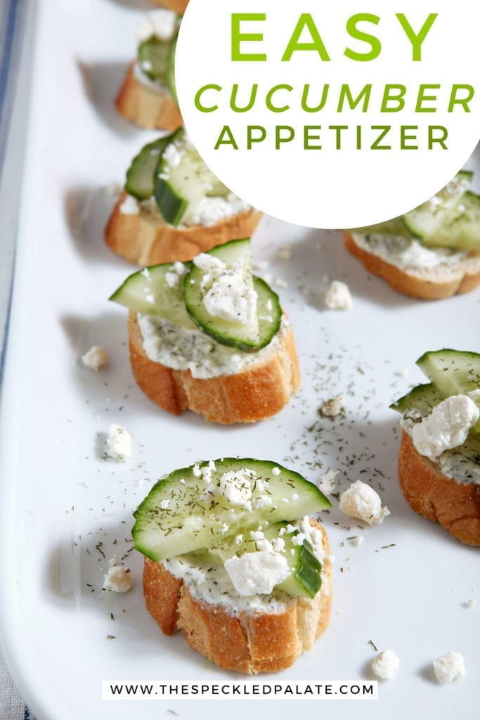 Cucumber garnishes toast with extra feta cheese and dill on a white platter with the text 'easy cucumber appetizer'
