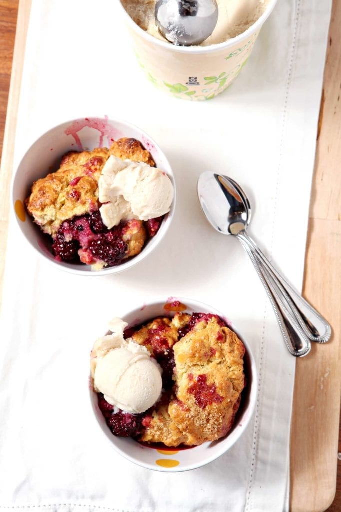 Dairy-Free Blackberry Cobbler is the ultimate summertime dessert. Blackberries are tossed in sugar and lemon zest, then roast beneath a cobbler topping. Serve with a scoop of your favorite (dairy-free) ice cream to top off this scrumptious treat.