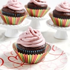 Chocolate-Covered Raspberry Cupcakes, complete with a raspberry chocolate cream cheese filling and a raspberry cream cheese frosting, are the best way to say HAPPY BIRTHDAY to a friend or family member! Easily made with Purely Simple cake and icing mix, these cupcakes are sure to be a hit.