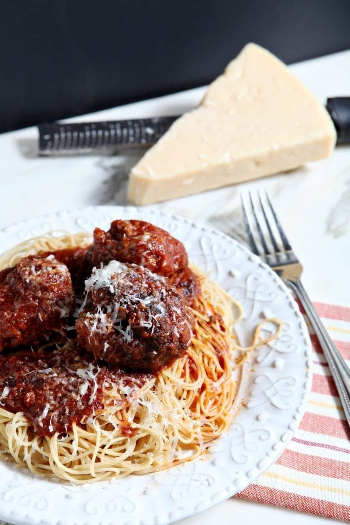 Classic beef and Italian sausage spaghetti and meatballs makes the ultimate comfort food. Tossed in a simple, flavorful tomato sauce and served over angel hair pasta, it's hard not to love this dish.