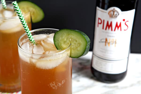 Close up of a cocktail next to a Pimm's No. 1 bottle