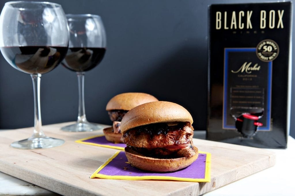 With football season kicking off this weekend, these Pork Tenderloin Sliders with a Red Wine Reduction Sauce are the perfect tailgate entree! Marinate the pork overnight in Black Box Merlot and a few other ingredients, then toss it on the grill at your tailgate party for a delicious sandwich! You can use the wine to make a delicious reduction to top the sliders. #ad #SummerToGo #BlackBoxWines