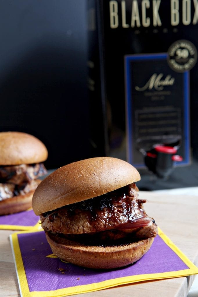 Two sliders in front of box of wine