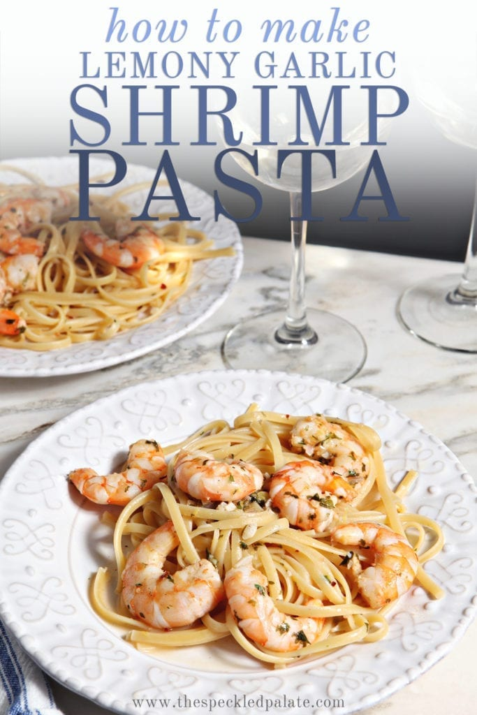 Lemon Shrimp Pasta on a white plate with a fork on marble with a glass of wine with the text 'how to make lemon garlic shrimp pasta'