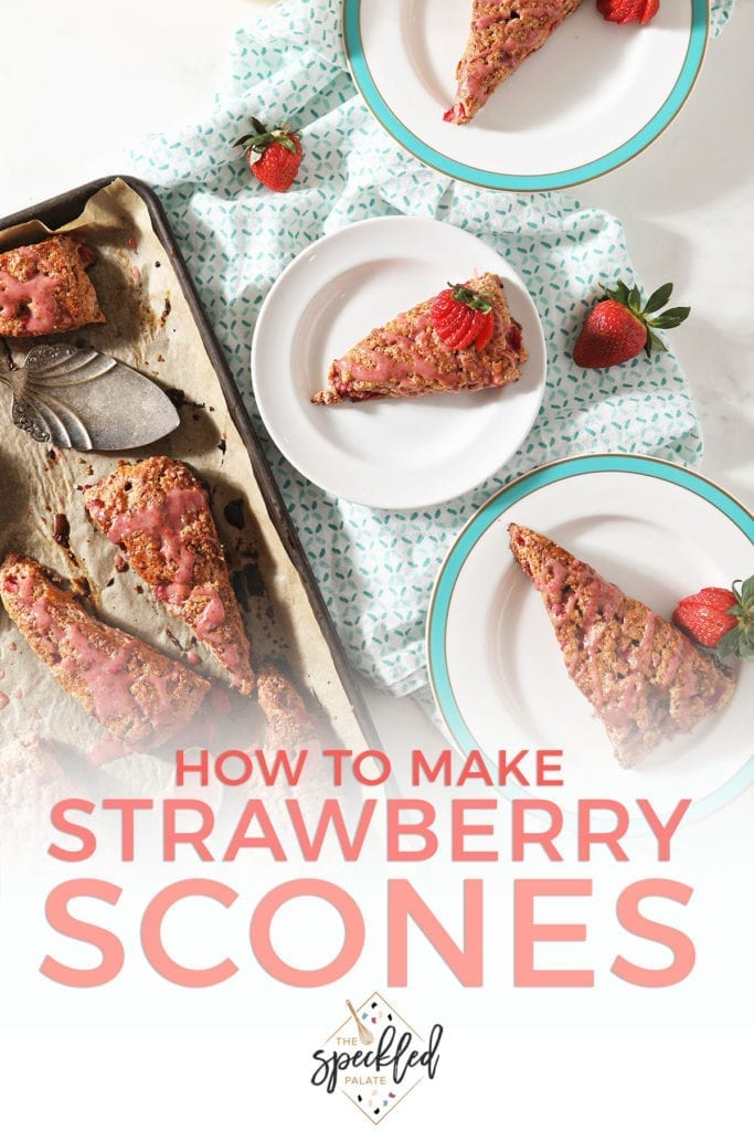 Three plates hold strawberry scones next to a baking sheet with more scones on it with the text 'how to make strawberry scones'