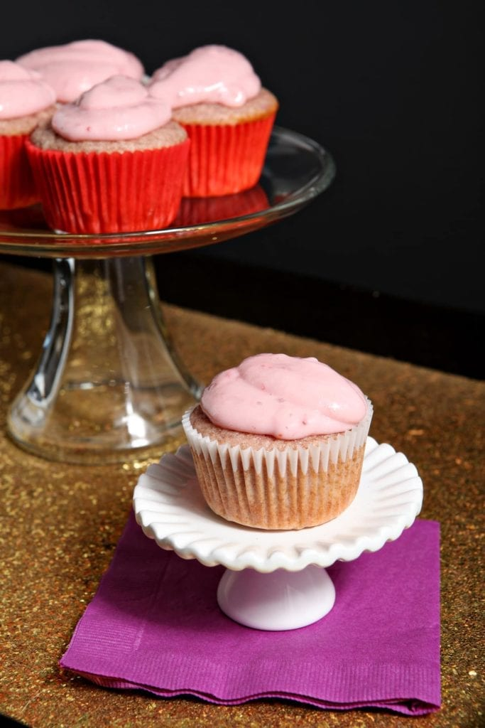 Small-batch Strawberry Cupcakes with Strawberry Cream Cheese Icing are the perfect sweet for a celebration. Made with fresh strawberry puree instead of strawberry-flavored ingredients, these cupcakes exude subtle strawberry flavor, then are topped with a decadent strawberry cream cheese icing for a final touch!