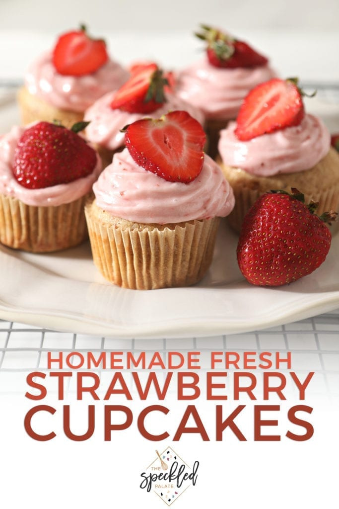 Decorated Strawberry Cupcakes on a white platter with the text 'homemade fresh strawberry cupcakes'