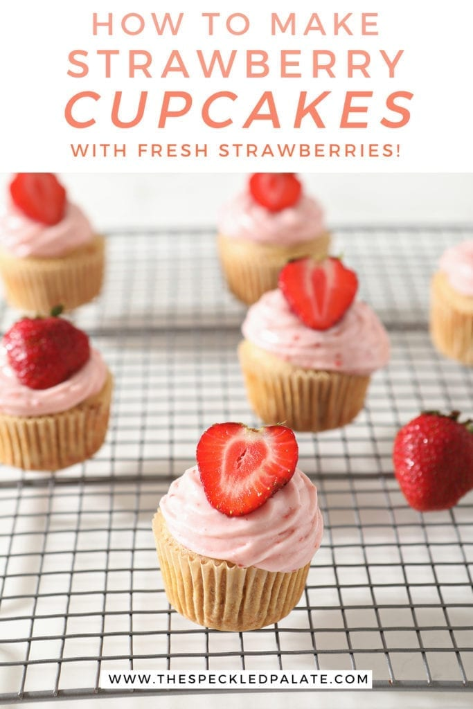 Decorated Strawberry Cupcakes on a wire cooling rack with the text 'how to make strawberry cupcakes with fresh strawberries'