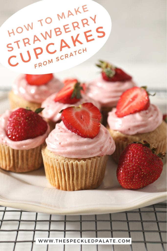 Decorated Strawberry Cupcakes on a white platter with the text 'how to make strawberry cupcakes from scratch'