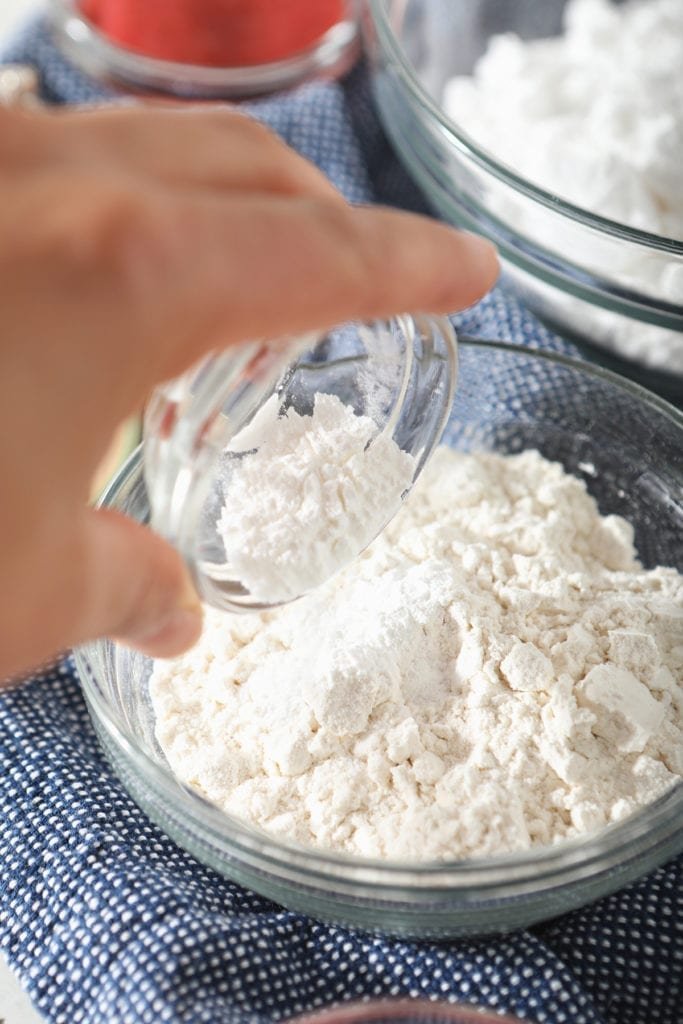 Dry ingredients are poured into one large bowl