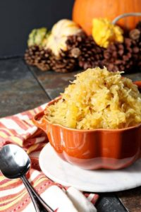In search of a vegan, grain-free Thanksgiving side? Look no farther than this simple, but incredibly flavorful Garlicky Spaghetti Squash. Spaghetti squash is baked, then shredded and sautéed with red pepper flakes and tons of garlic. #Thanksgiving #Blogsgiving2015 #sidedish #vegan #vegetarian
