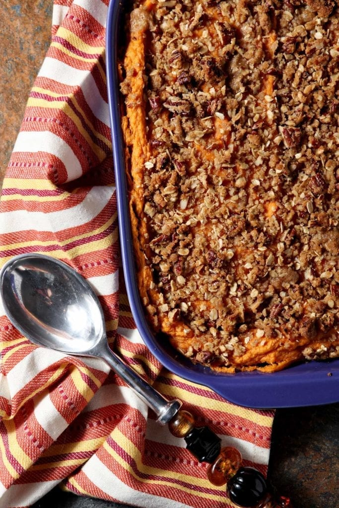 Knock the socks off your guests with this slightly sweet Bourbon Sweet Potato Casserole, covered with a crunchy streusel topping. The bourbon sings, the sweet potatoes are light and creamy, and the streusel topping adds texture to this take on a Thanksgiving classic. #Thanksgiving #Blogsgiving2015 #sidedish #sweetpotato #bourbon #vegetarian