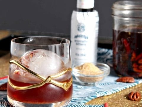 Close up of a Toasted Pecan Old Fashioned in decorative glass