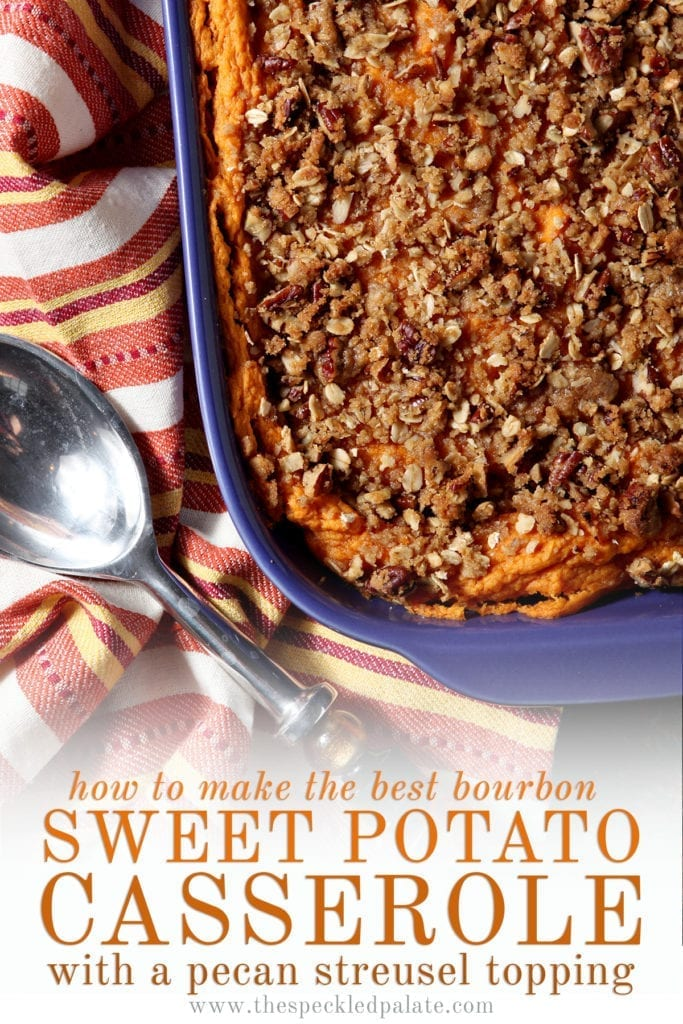 Close up of a casserole dish holding baked Bourbon Sweet Potato Casserole next to a silver serving spoon with the words 'how to make the best bourbon sweet potato casserole with pecan streusel topping'