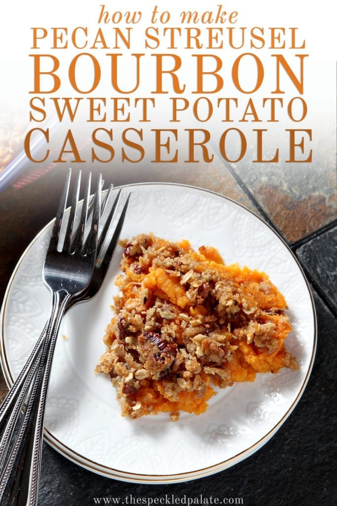 Close up of a white plate holding a serving of Bourbon Sweet Potato Casserole next to two silver forks with the text 'how to make pecan streusel bourbon sweet potato casserole'