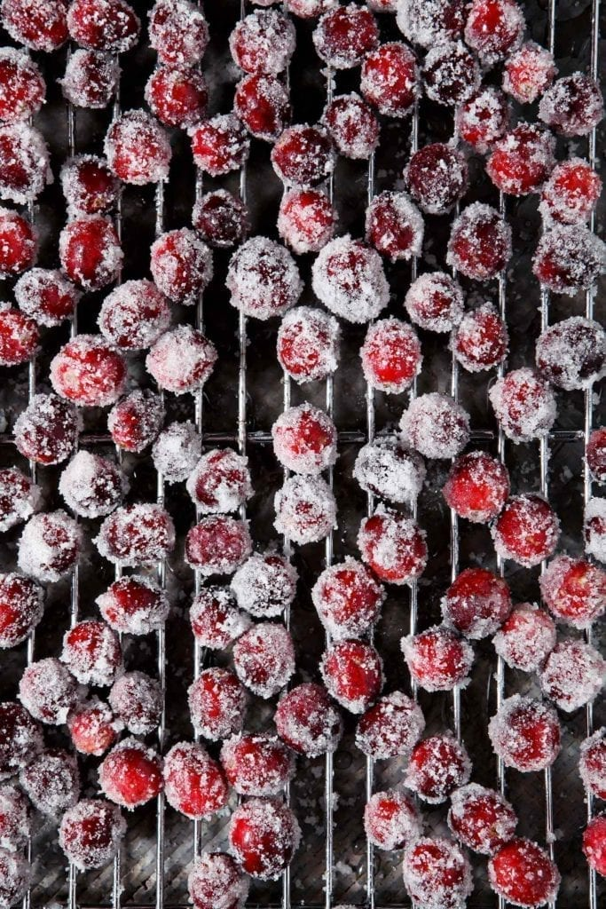 Sugared cranberries dry on a metal cooling rack