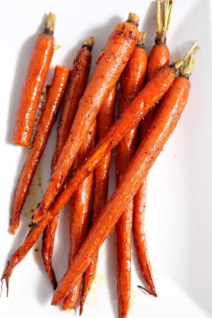Overhead close up of roasted carrots on dish