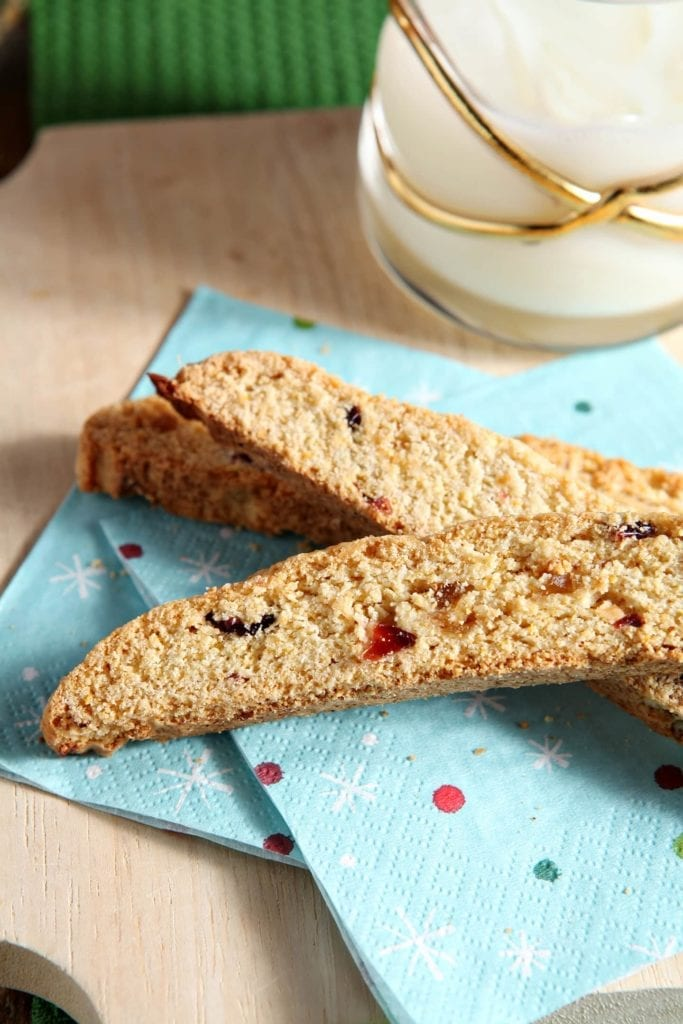 Perfectly crunchy cookies are chock full of cranberries, orange and ginger goodness to make these beautiful Cranberry Orange Ginger Biscotti. This biscotti is the perfect cookie for anyone who prefers non-chocolate cookies.
