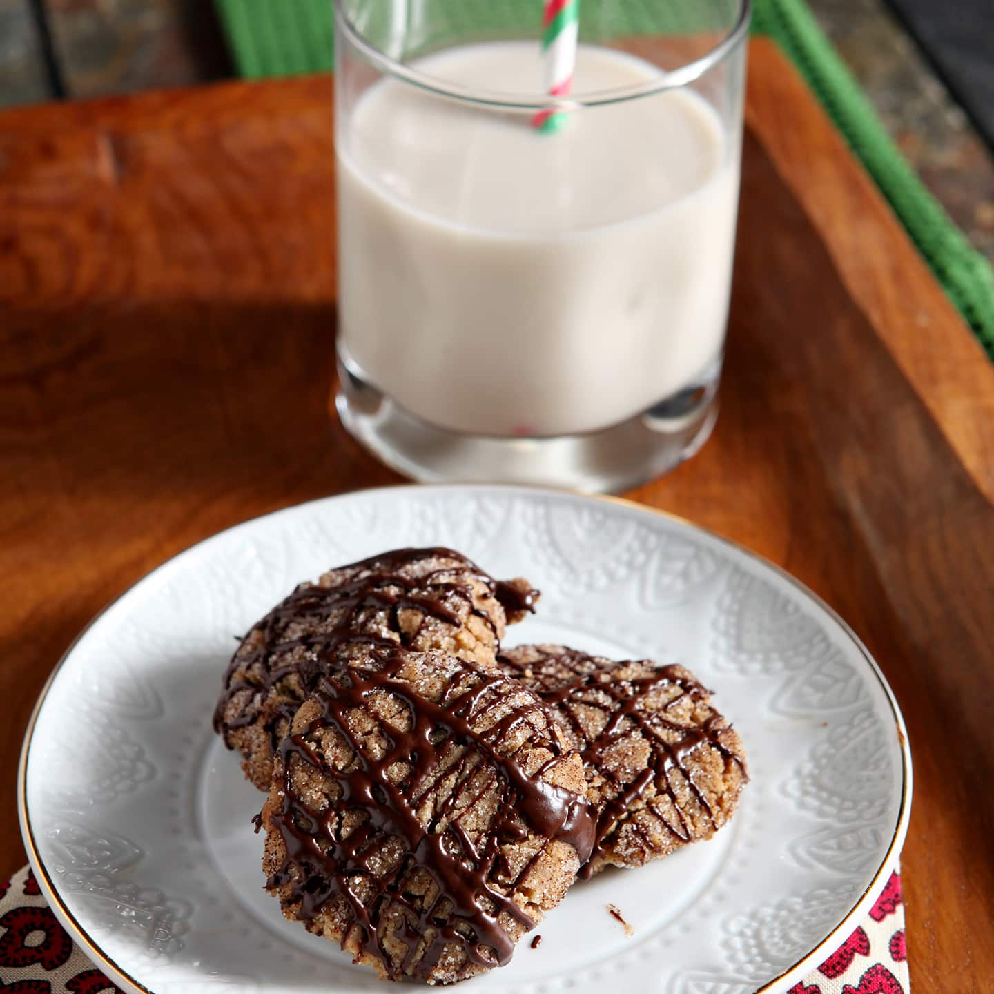 A twist on the classic Peanut Blossom Cookies, these Vegan Peanut Butter Espresso Cookies are rich, crunchy and delicious. Vegan peanut butter and espresso cookies are drizzled with a chocolate espresso glaze that makes the cookies sing!