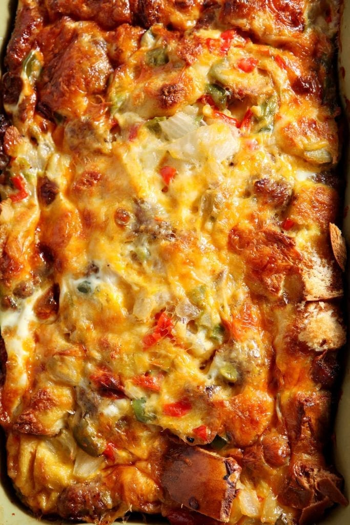 Close up overhead image of a baking dish full of Christmas Breakfast Casserole before serving.