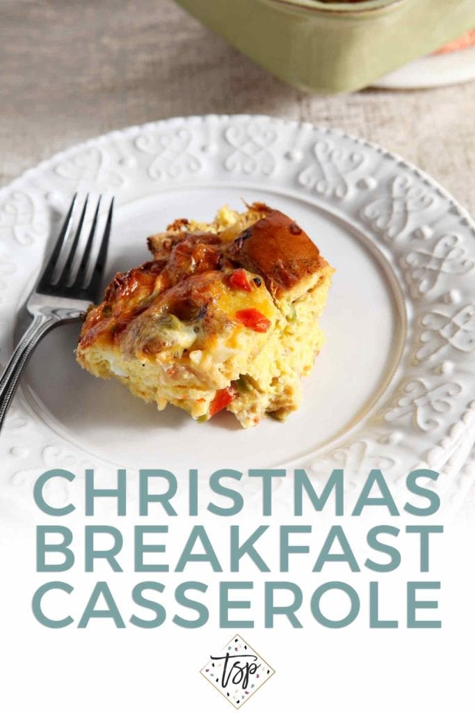 Pinterest graphic for Christmas Breakfast Casserole, featuring a serving of the casserole on a white plate with a fork